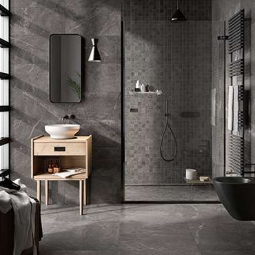 National Tile. Blue Savoy. Stone look modular formats porcelain tiles for bathroom walls and floors.