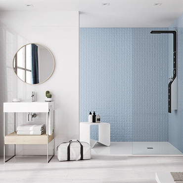 National Tile. Cromatica. Monochromatic high gloss tiles with 3D effect and patterned decors for bathroom walls.