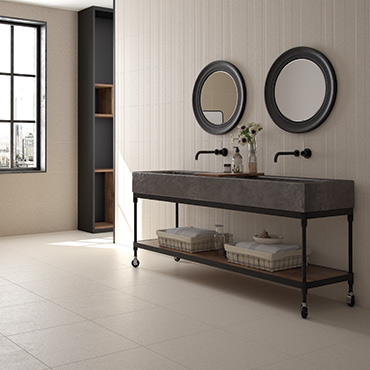 National Tile. Limestone. Multi format stone look tiles with 3D effect pattern in lined and striped decor for bathroom walls and floors.