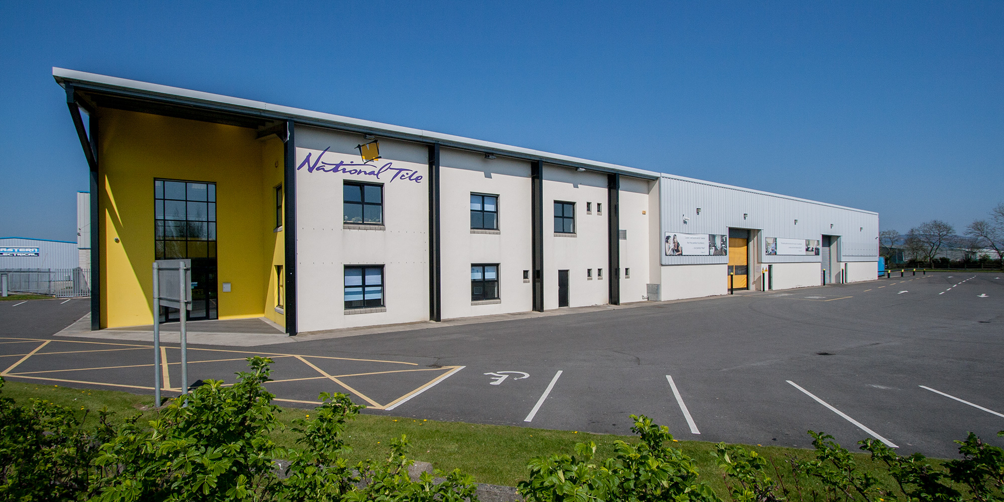 National Tile head office building. Tiles and wood flooring retail showroom, wholesale sale office, the biggest tile and wood flooring store and distribution centre in Ireland.