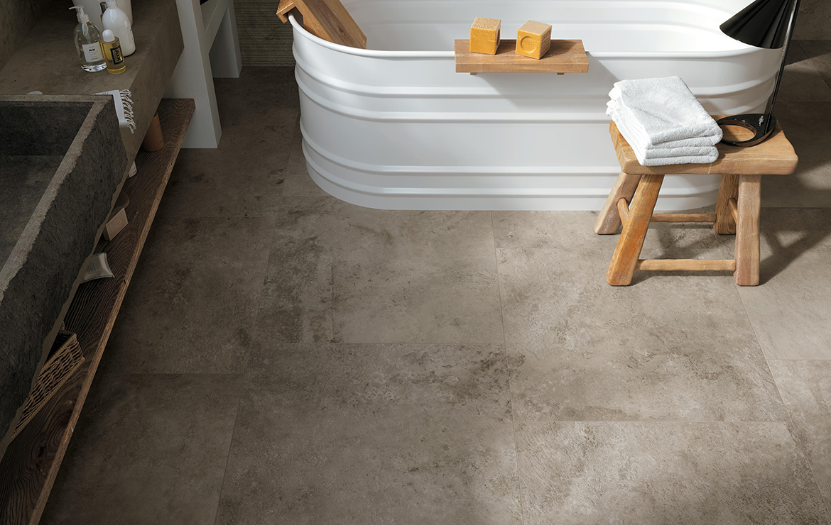 Aix Cendre 37.5x75. Rustic style bathroom floor design with stone look porcelain tiles.