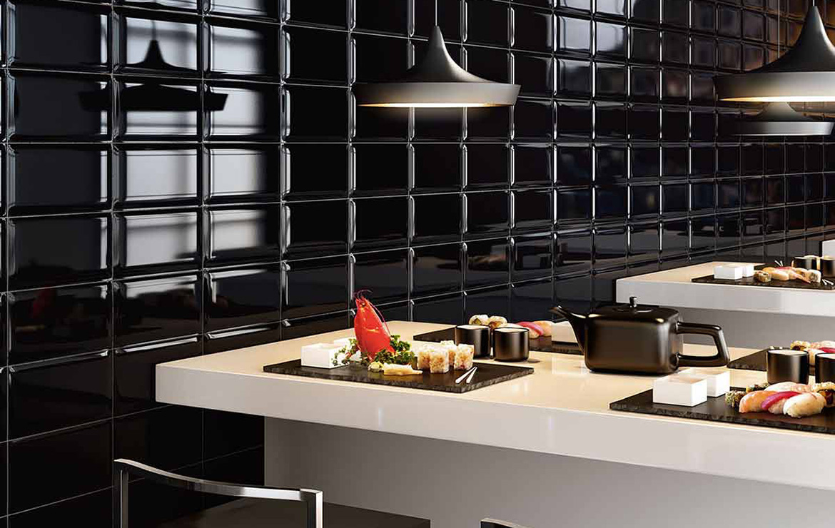 Biselado Negro 10x20. Exclusive restaurant wall design with high gloss black bevelled wall tiles.