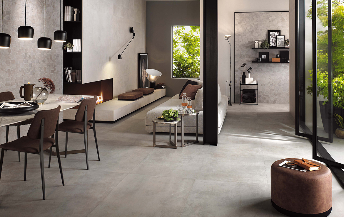 Modern style living room interior design with concrete effect large format porcelain tiles - Boost Pearl and White 120x120.