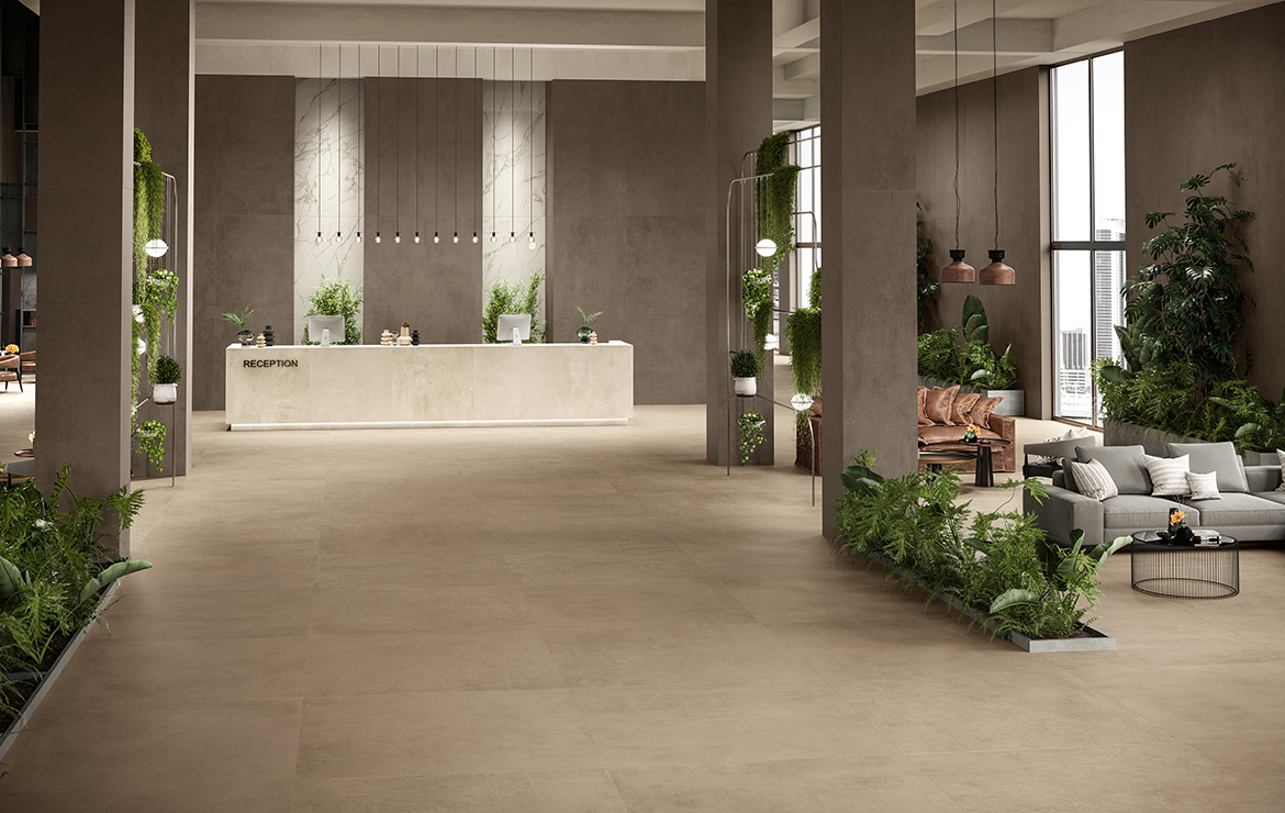 Modern style hotel reception interior design with concrete effect large format porcelain tiles - Boost Clay and Taupe 120x120.