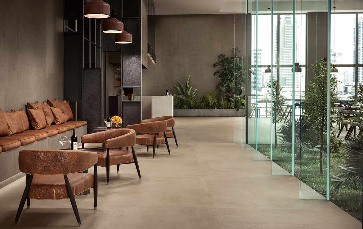 Modern style Facebook restaurant interior design with concrete effect large format porcelain tiles - Boost Taupe 120x120.