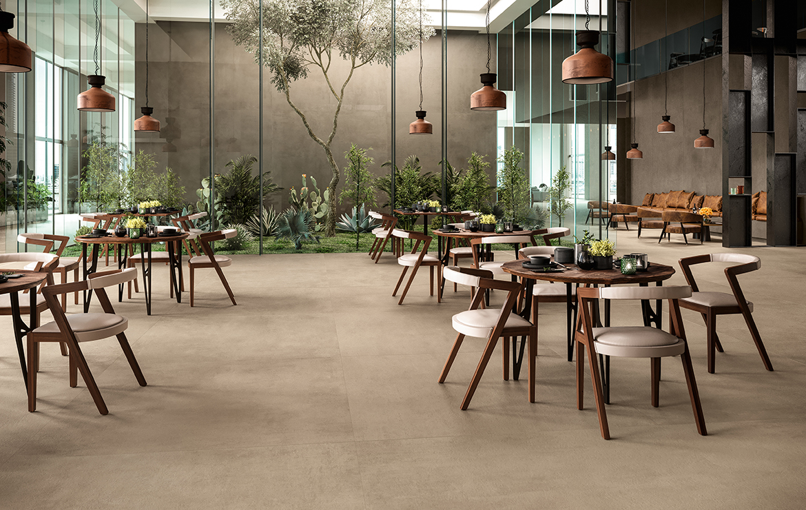 Modern style company restaurant interior design with concrete effect large format porcelain tiles - Boost Taupe 120x120.