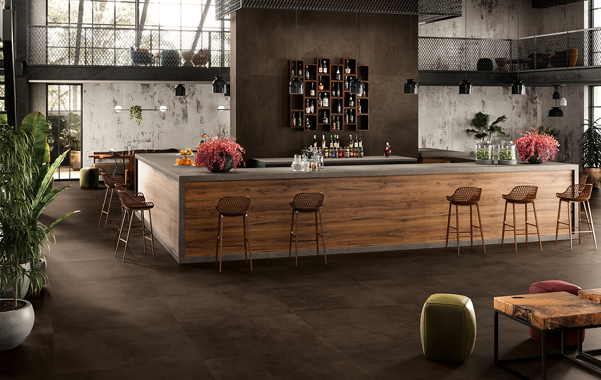 Modern style bar interior design with concrete effect large format porcelain tiles - Boost Tobacco 120x120.