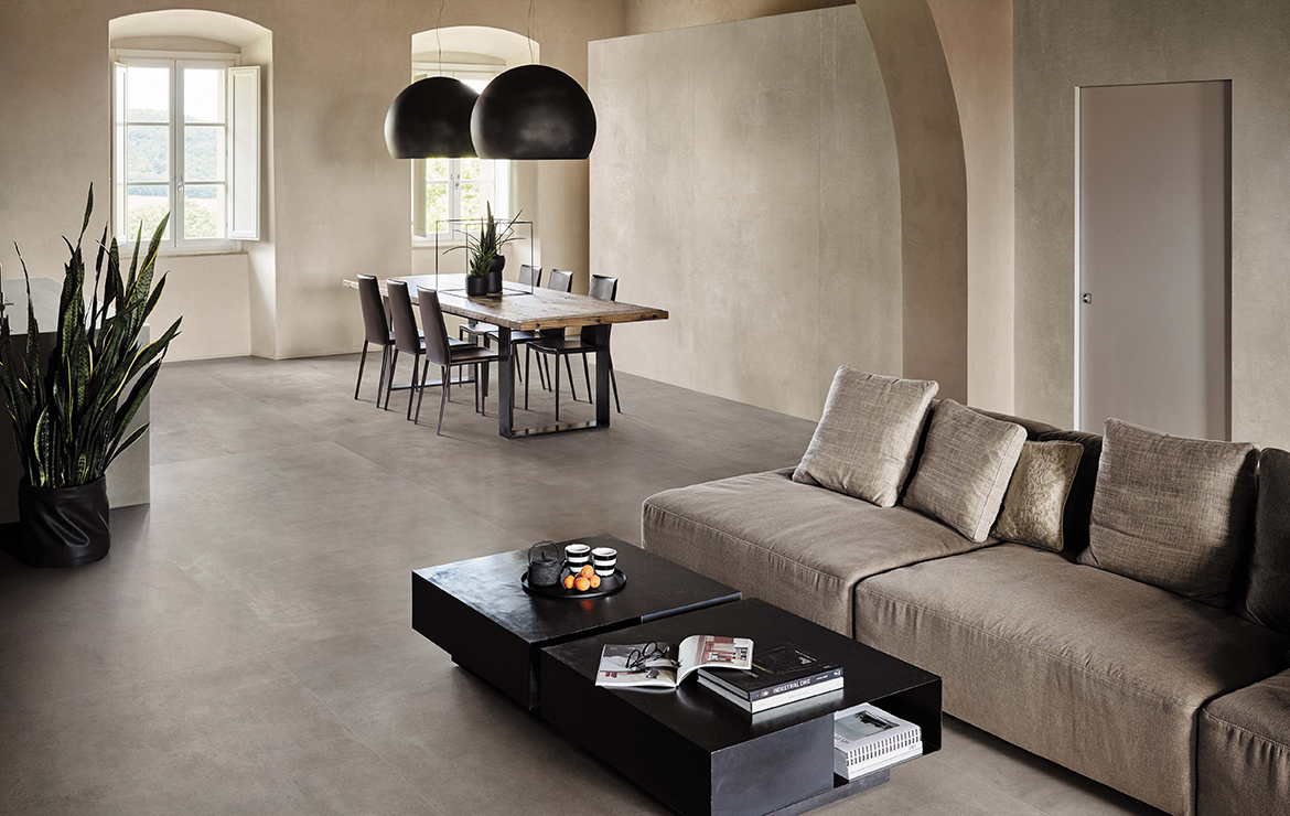 Rustic style villa living room interior design with concrete effect large format porcelain tiles - Boost White 120x120.