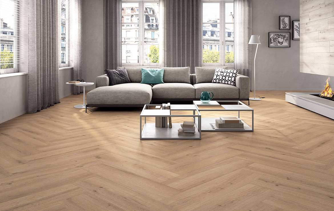 Modern style apartment living room interior design with herringbone pattern wood look floor tiles Breath Natural 22.5x90.