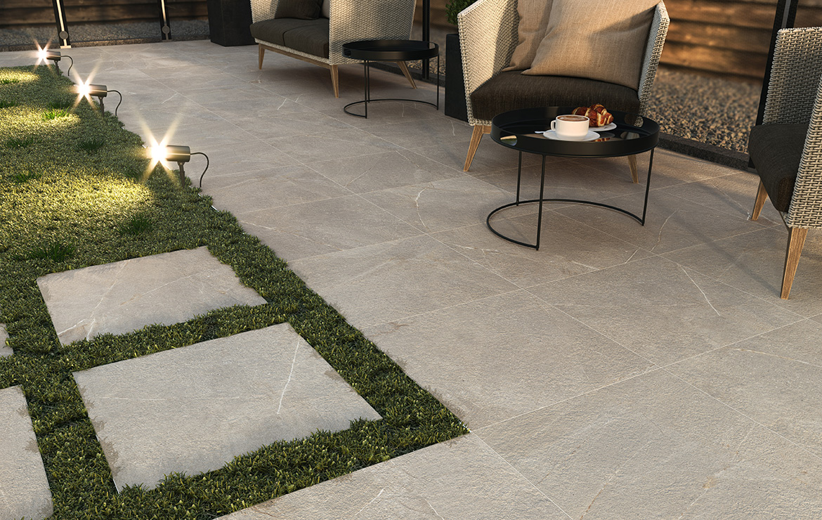Exterior garden patio floor design made with anti-slip 20mm porcelain paving tiles on the grass. Madison Duplo Bone 60x60.