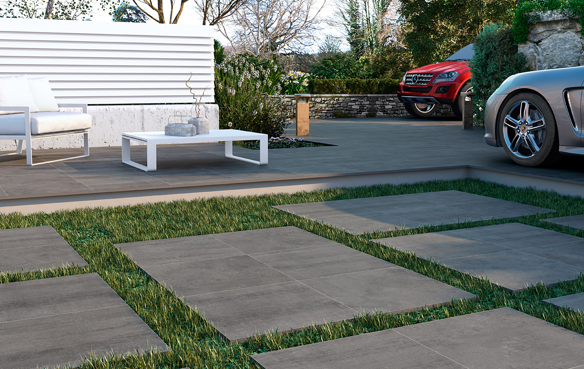 Exterior garden patio made with anti-slip 20mm porcelain paving tiles and adjustable support pedestals. Madison Duplo Argent 60x60.