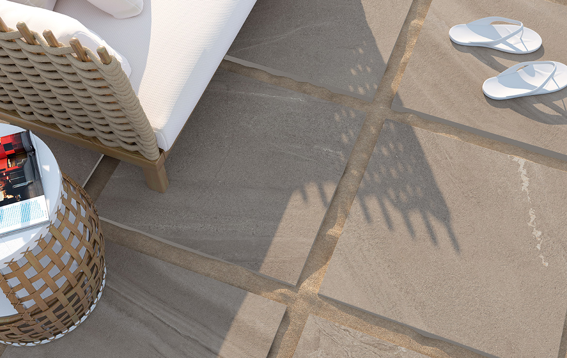 Exterior garden patio made with anti-slip 20mm porcelain paving tiles on the sand. Madison Duplo Bone 60x60.
