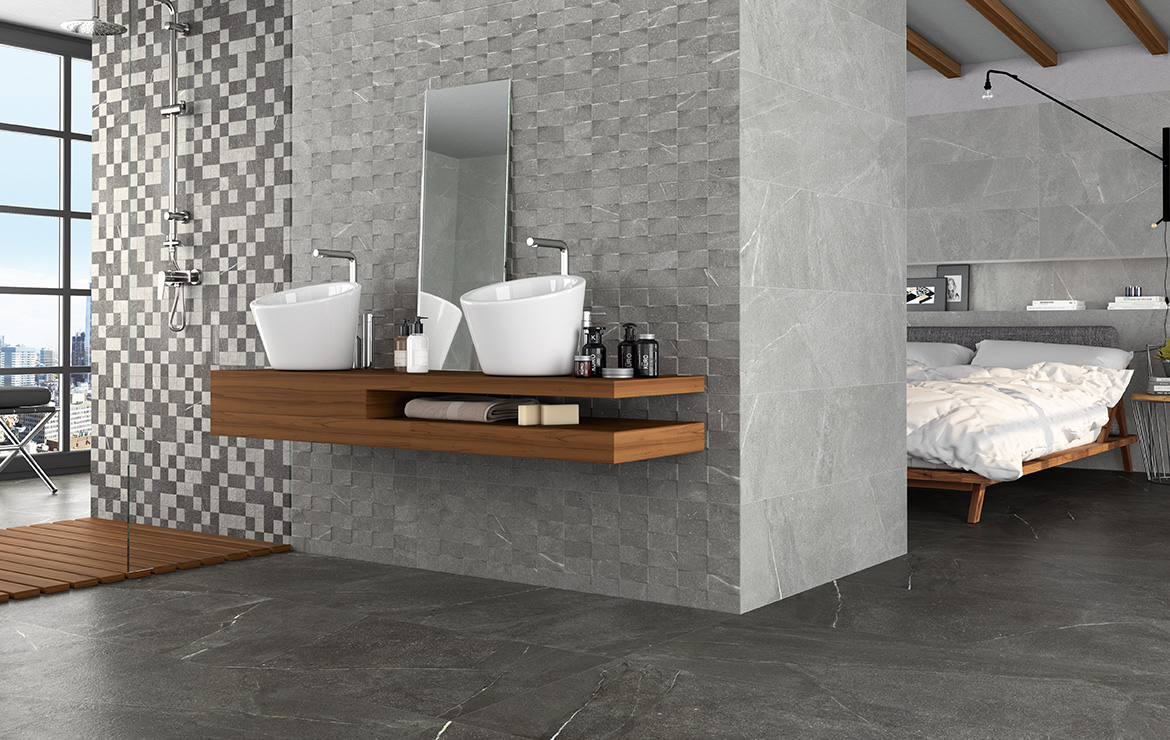 Wall: Madison and Top Argent 30x60. Floor: Madison Grafito 60x60. Modern style open plan bathroom and bedroom interior design with stone look wall and floor porcelain tiles.