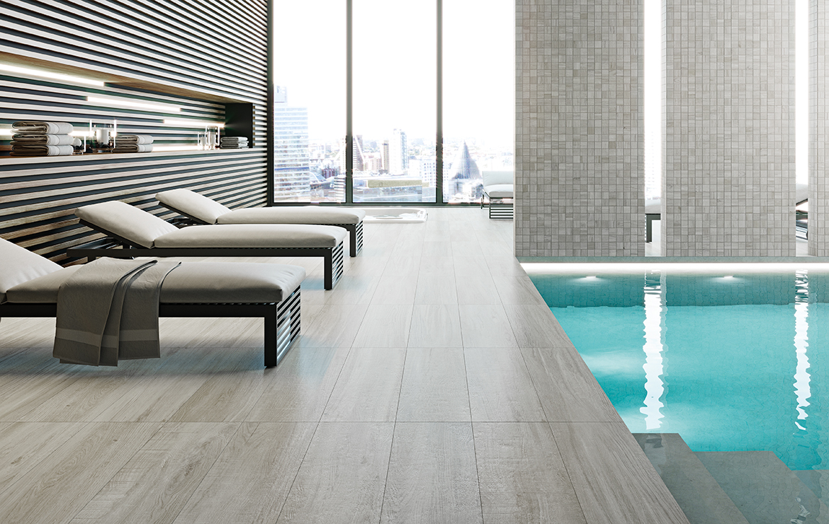 Wellness centre / SPA swimming pool interior design with light grey rustic wood-look porcelain wall and floor tiles - Mistral Ash 22x84.