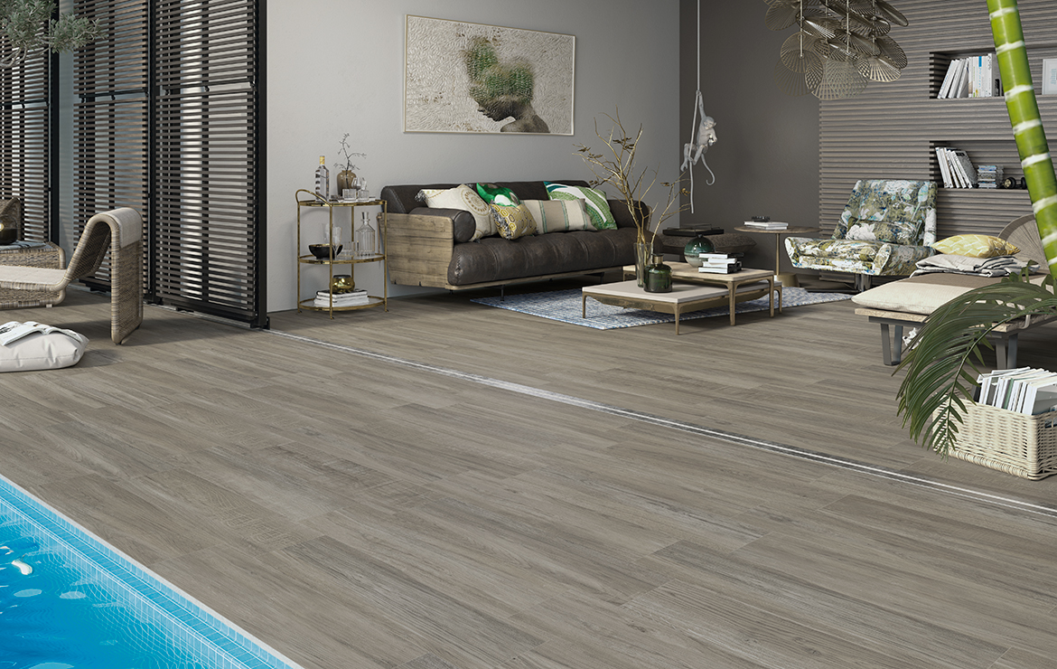 Open plan living room and terrace with rustic wood-look porcelain wall and floor tiles - Mistral Olive 22x84.