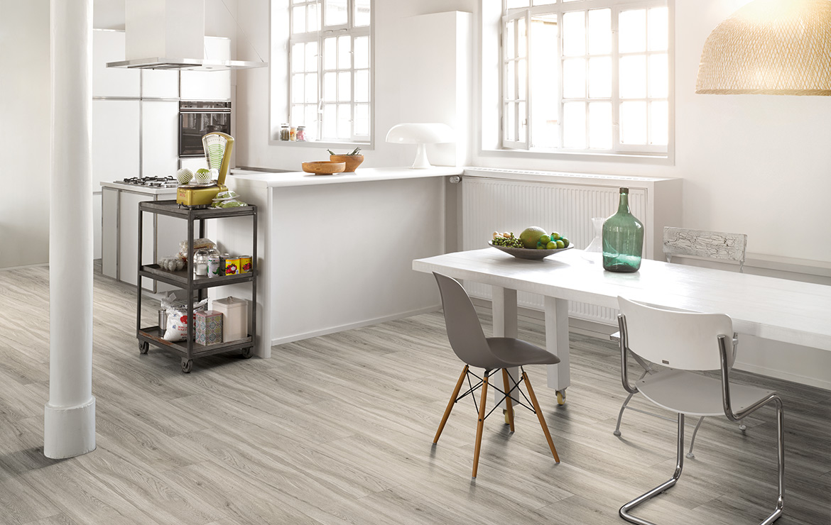 Kitchen interior design with wood effect vinyl flooring Parador Basic 5.3 Pastel Grey Oak 1209x225x5.3mm.
