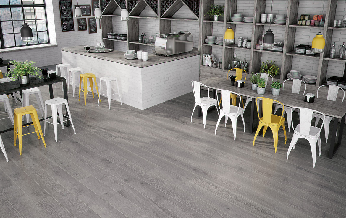 Coffee Shop interior design with light grey oak wood look porcelain floor tiles - Rovere Pearl 22.6x90.