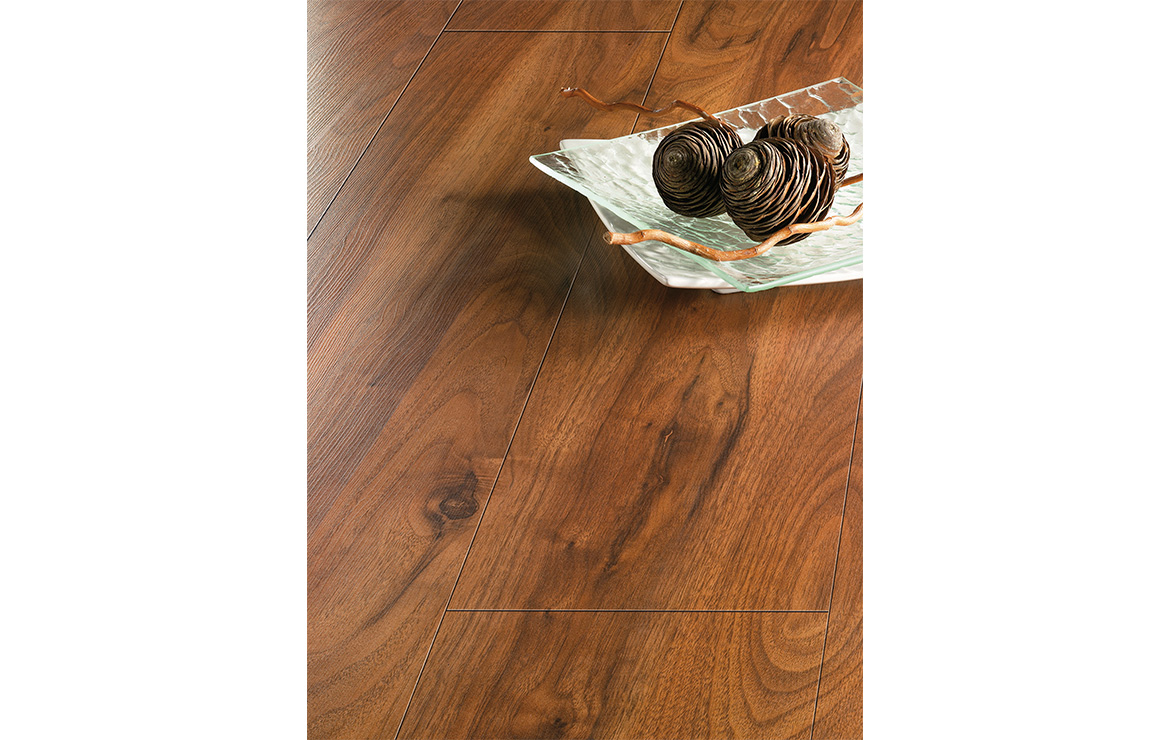 Floor design with 12mm wood look laminate flooring with the highest abrasion resistance rating AC6 - Solid Authentic Walnut.