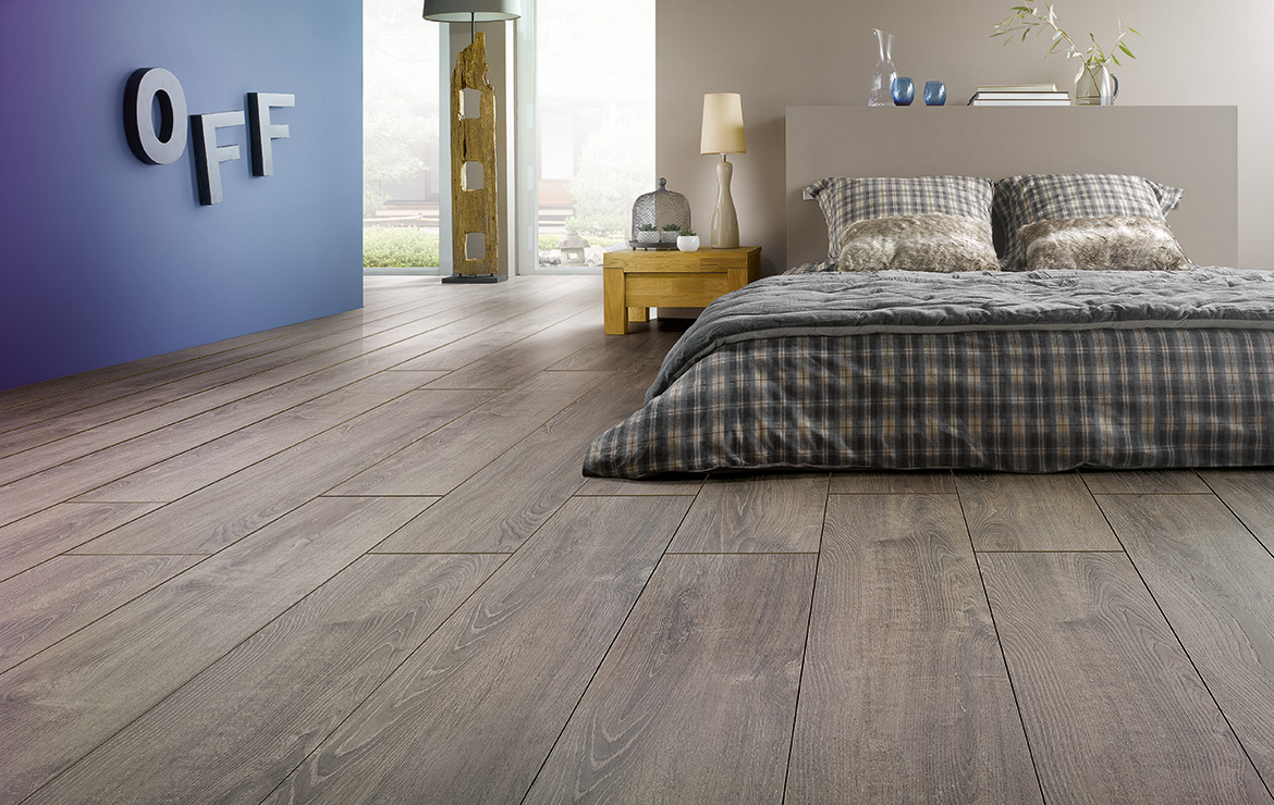 Modern bedroom interior design. 2 bedroom apartment Dublin. 12mm wood look laminate flooring with the highest abrasion resistance rating AC6 - Solid Plus Corfou Oak.