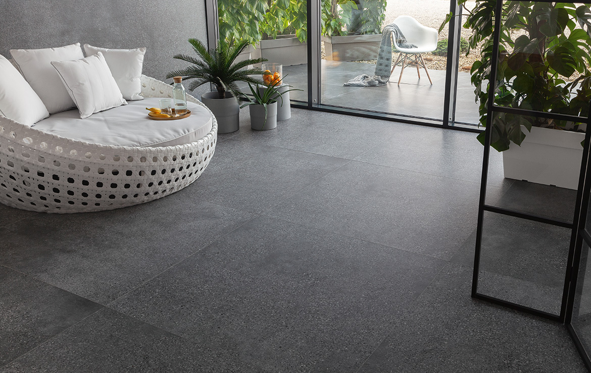 Modern style living room interior design with extra large format terrazzo look porcelain tiles Terazzo Graphite Matt 60x120.