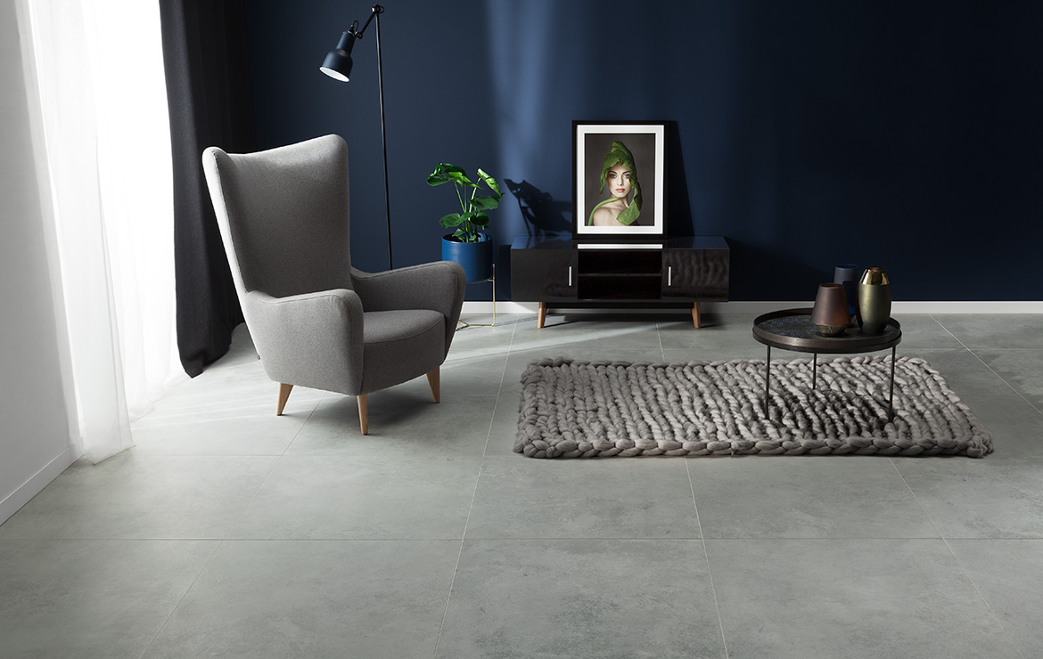 Modern style living room interior design with large format concrete look porcelain tiles Torano Grey Matt 80x80.
