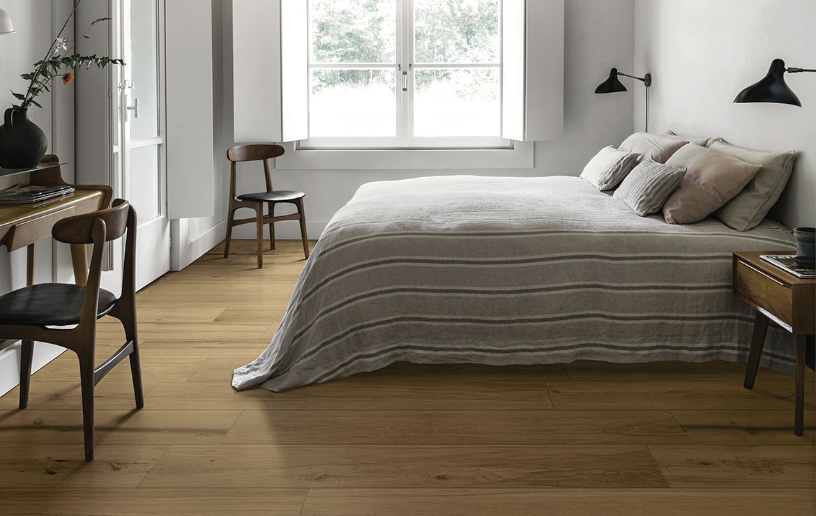 Nordic style bedroom interior design with extra long plank rustic wood look porcelain tiles Treverklife Honey 20x120.