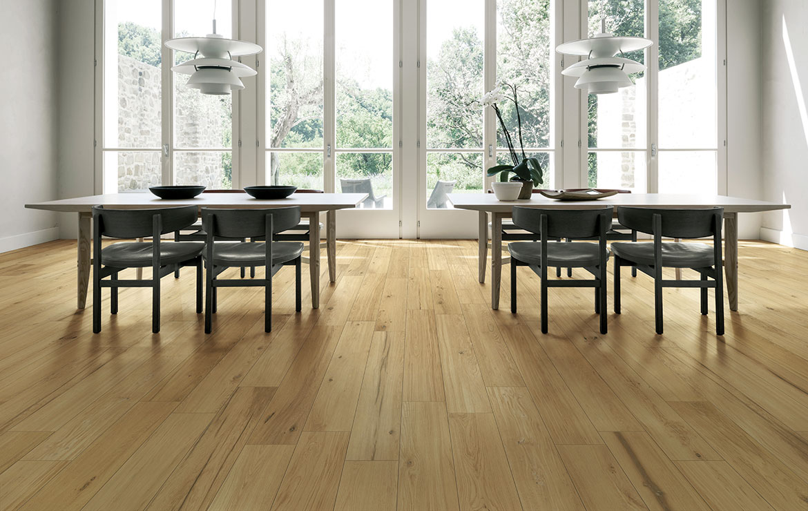 Nordic style dining room interior design with extra long plank rustic wood look porcelain tiles Treverklife Honey 20x120.
