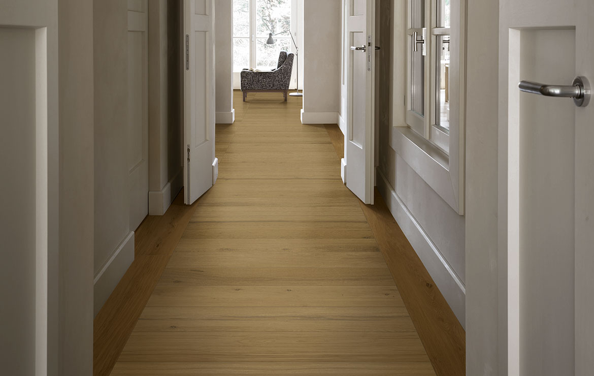 Hallway interior design with extra long plank rustic wood look porcelain tiles Treverklife Cherry 20x120.