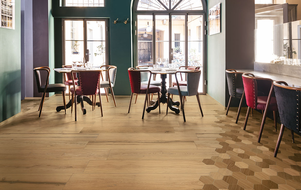 Stylish French coffee shop interior design with extra long plank rustic wood look porcelain tiles Treverklife Cherry 20x120.
