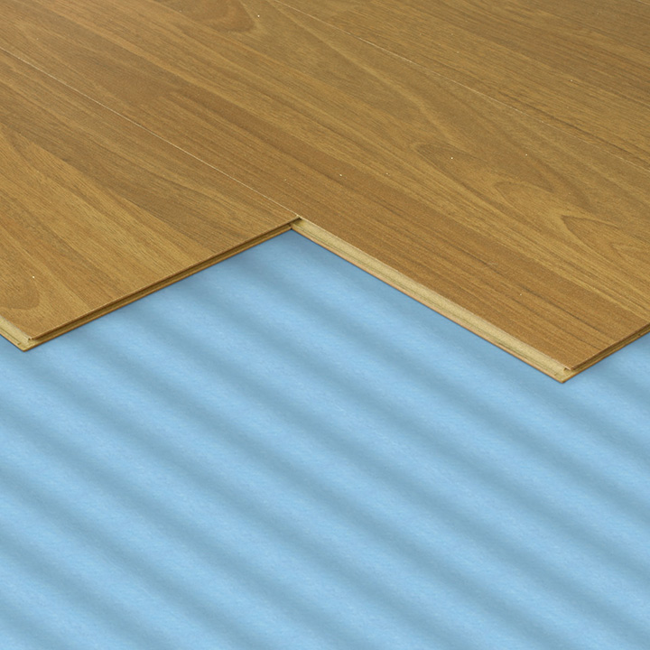 Wood flooring fitting. Blue underlay.