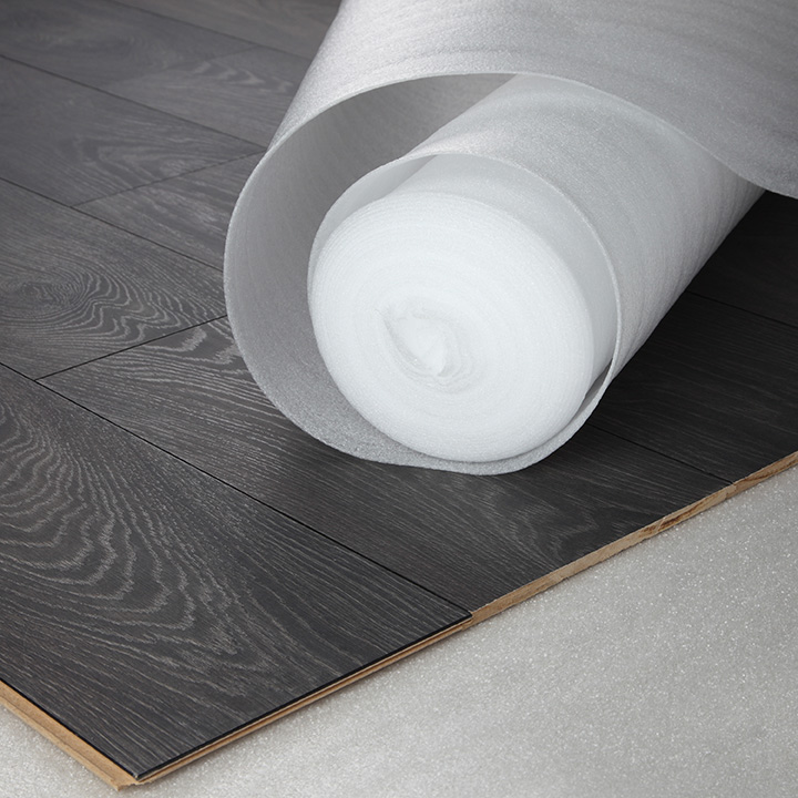 Wood flooring fitting. White foam underlay.