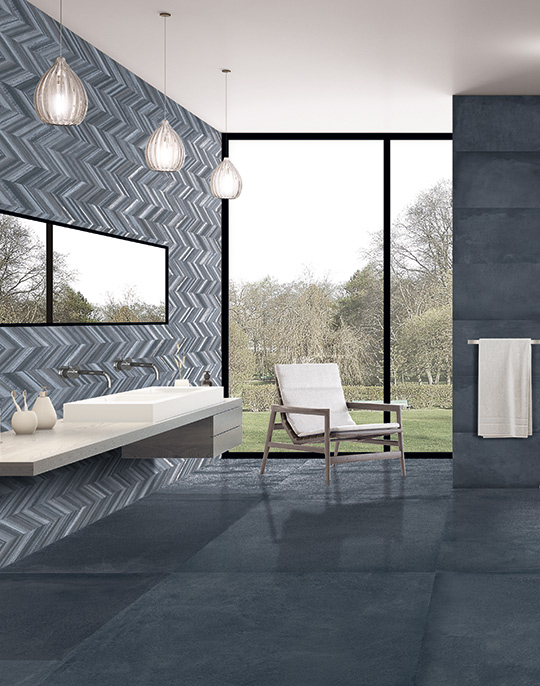 Cromat One multi sizes concrete look monocolour tiles with embossed decors for bathroom walls and floors. View collection.