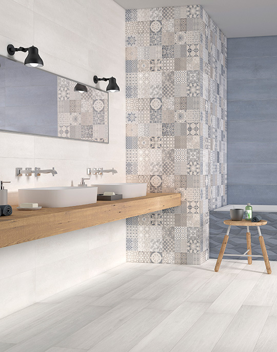District 25x75 / 45x45. Concrete look tiles with wavy 3D effect and patterned decors for bathroom walls and floors. View collection.