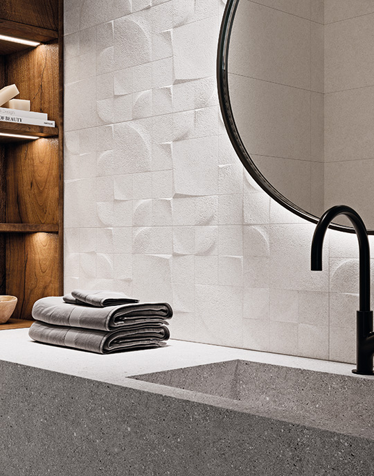 Kone Mate 30x90 / 60x60. Large format stone look bathroom wall and floor tiles. View collection.