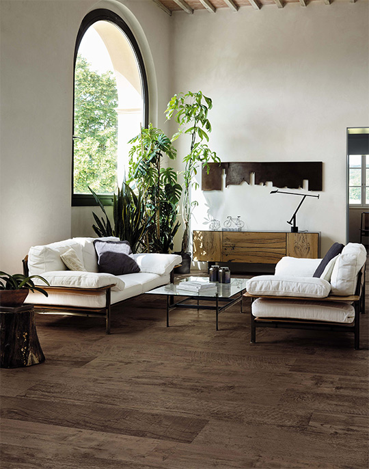 Nash 18.5x150. Extra long plank aged oak wood look porcelain floor tiles. View collection.